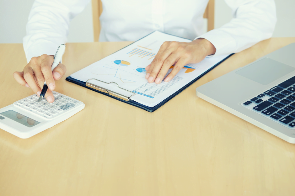Company Accountant reviewing business figures